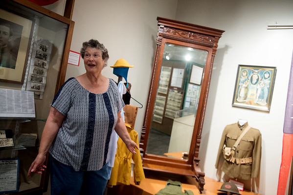 Michele Hansford talks about a mirror from the Powers House, which is listed on a new digital history map of Carthage, during an interview on Wednesday at the Powers Museum.<br /> Globe   Roger Nomer
