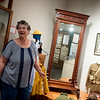 Michele Hansford talks about a mirror from the Powers House, which is listed on a new digital history map of Carthage, during an interview on Wednesday at the Powers Museum.<br /> Globe | Roger Nomer