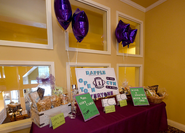 Items up for raffle to raise money for Alzheimer's research sit in the lobby on Tuesday at College View Manor. <br /> Globe | Laurie Sisk