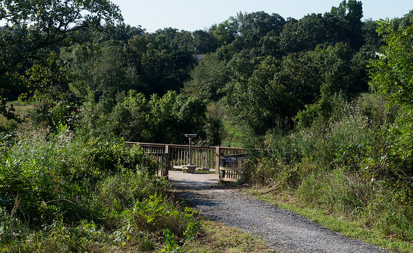Brush has been cleared away from the path to the observation area behind the Shoal Creek Conservation Education Center.<br /> Globe   Roger Nomer