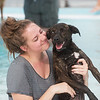 Cate Larimer cuddles her dog Wilson on Saturday during the Doggie Dive In at Ewert Park.<br /> Globe | Roger Nomer