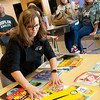 Sandra Cantwell, executive director of student services, displays books donated by The Alliance of Southwest Missouri on Monday at Joplin High School.<br /> Globe | Roger Nomer