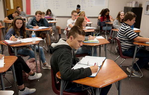 Ethan Coggeshell, sophomore, studies on Wednesday at College Heights Christian School.<br /> Globe | Roger Nomer