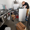 From the left: Josh Johnson and Adam Landburg, of Johnson Plumbing, install equipment at Cat Johnson's Taste of the South on Wednesday.<br /> Globe | Laurie Sisk