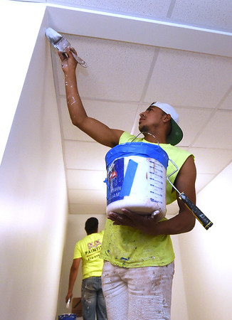 Lynn Lenin, of M&M Painting, puts some finishing touches on a hallway inside the National Bank Building - part of the Block22 project - on Tuesday in downtown Pittsburg.<br /> Globe | Laurie Sisk