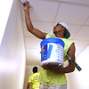 Lynn Lenin, of M&M Painting, puts some finishing touches on a hallway inside the National Bank Building - part of the Block22 project - on Tuesday in downtown Pittsburg.<br /> Globe   Laurie Sisk