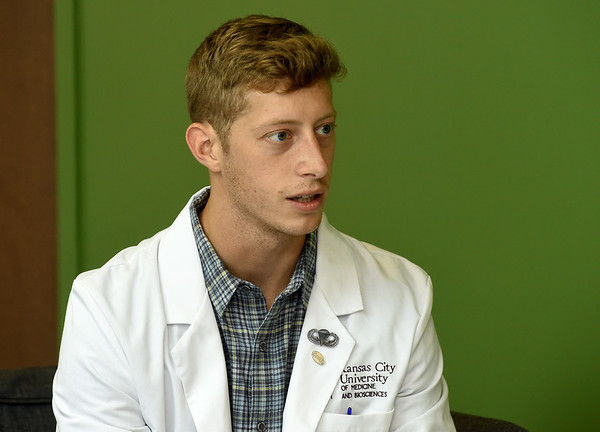 On Wednesday at Kansas City University, second-year KCU student Charles Coker, of Edmond, Okla., talks about the experience she has gained working at the Community Clinic of Joplin.<br /> Globe | Laurie Sisk
