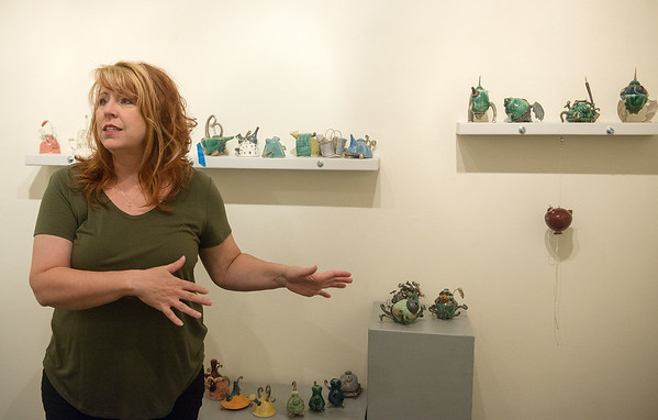 Angel Brame talks about her teapots on Wednesday at the Spiva Center for the Arts.<br /> Globe | Roger Nomer