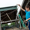 Malichi Barnes, 9, Miami, practices his roping technique at the Ottawa County Fair on Friday.<br /> Globe | Roger Nomer