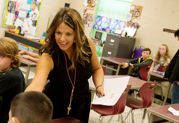 Jeni Vieselmeyer teaches her math class on Thursday at North Middle School.<br /> Globe | Roger Nomer