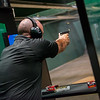 Travis Walthall, continuing education coordinator, demonstrates Missouri Southern's new firing range on Thursday.<br /> Globe | Roger Nomer