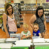 From the left: Melissa Conner and her twins, Jordan and Aidan Conner, 5, join Megan Aldridge as they shop for video games on Thursday at Vintage Stock. A proposed use tax aims to level the playing field for brick and mortar stores versus online out-of-state purchases.<br /> Globe | Laurie Sisk