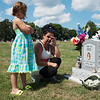 Tammy Jones wipes away a tear as she visits her grandson's gravestone with her granddaughter Lilly Harvel, 7, at the New Salem Cemetery in Neosho.<br /> Globe | Roger Nomer