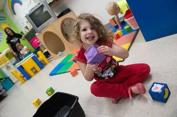 Izabella Grissom, 3, plays at the Cerebral Palsy of Tri-County Center in Webb City on Tuesday.<br /> Globe | Roger Nomer