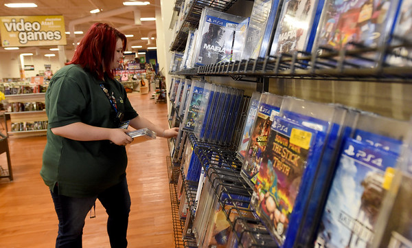 Vintage Stock Video Game Manager Elizabeth Barstow organizes games on Thursday at Northpark Mall. A proposed use tax aims to level the playing field for brick and mortar stores versus online out-of-state purchases.<br /> Globe | Laurie Sisk