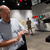 Larry Hicks, executive vice president of Cardinal Detecto, talks about a product in the company's new showroom on Friday.<br /> Globe | Roger Nomer