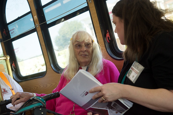 Evelyn Clawson talks Sarah Frost, with TranSystems, while riding a trolley on Wednesday.<br /> Globe | Roger Nomer