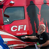 Michael Slack, CFI driver and US Navy veteran, checks out his new True to the Troops truck on Tuesday.<br /> Globe | Roger Nomer