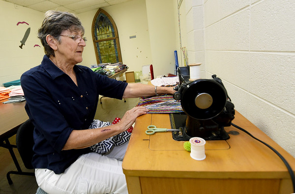 Carol McCombs works on an old Singer sewing machine used to make many of the skirts to be shipped to girls in a Haitian orphanage on Thursday at First United Methodist Church in Carthage. The skirts were sewn by about two dozen volunteers.<br /> Globe | Laurie SIsk
