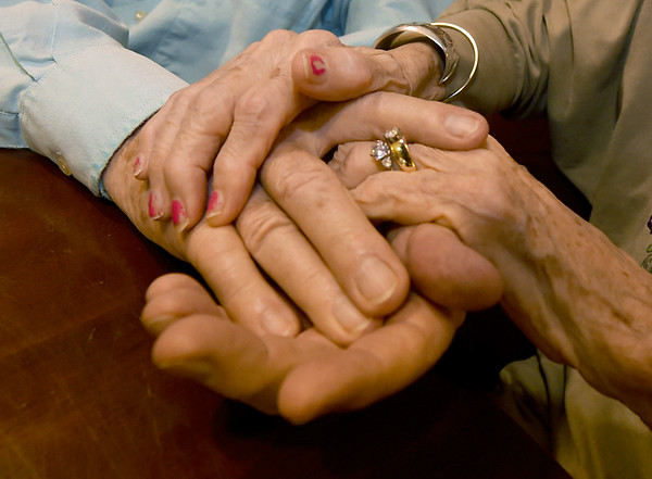 Frank and Florlene Young hold hands on Tuesday at College View Manor. Frank is Florlene's primary caretaker as Florlene battles Alzheimer's.<br /> Globe | Laurie Sisk