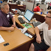 Ray Tupper, left, talks with Justin Hatfield, Joplin, on Thursday at the Joplin Job Center.<br /> Globe | Roger Nomer