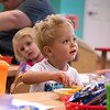 Wyatt Baykin, 2, eats a snack at Midtown Head Start on Wednesday.<br /> Globe | Roger Nomer