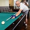 Gordon Sechrist lines up a shot as Leonard Orcutt looks on Thursday at the Joplin Senior Center.<br /> Globe | Laurie Sisk