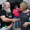 Michael Slack, CFI driver and US Navy veteran, is congratulated on his new truck by his fleet supervisor Jennifer Adams on Tuesday at CFI.<br /> Globe | Roger Nomer