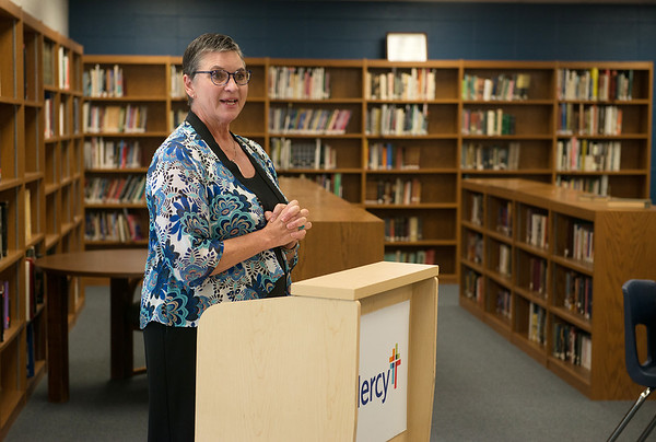 Georgiana McGriff, director of Joplin Area Catholic Schools, talks during the Project Lead the Way event at McAuley High School on Aug. 8.<br /> Globe | Roger Nomer