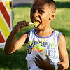 Five-year-old Torren Rogers, of Cleveland, Ohio finds some shade and an icy treat on Friday night at Park Days in Ewert Park. The event featured music, children's activities and vendors equipped with a variety of food.<br /> Globe | Laurie Sisk