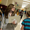 Shawna Brooks helps sixth graders to their classes on Thursday at North Middle School. <br /> Globe | Roger Nomer
