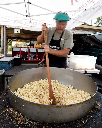 Howard Burnison, of Kins Kettle Corn, stirs a fresh batch during a busy Saturday at the Webb City Farmers Market.<br /> Globe   Laurie Sisk
