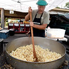 Howard Burnison, of Kins Kettle Corn, stirs a fresh batch during a busy Saturday at the Webb City Farmers Market.<br /> Globe | Laurie Sisk