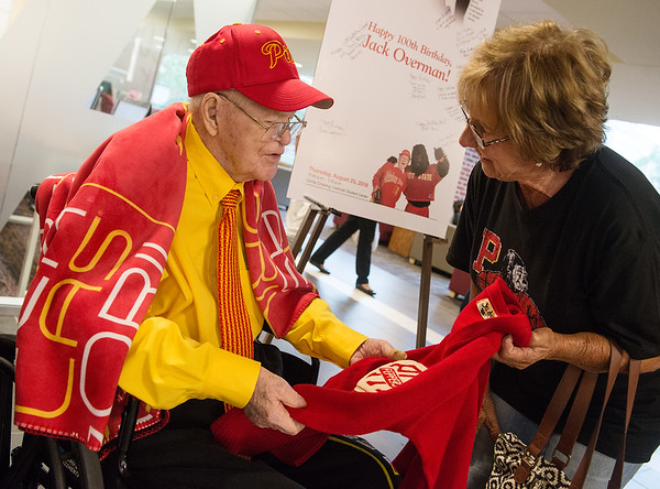Jack Overman talks with Judy Ausemus-Hunt, Pittsburg, as she shows him her pep club shirt from her time at Pittsburg State on Thursday at the Overman Student Center.<br /> Globe | Roger Nomer