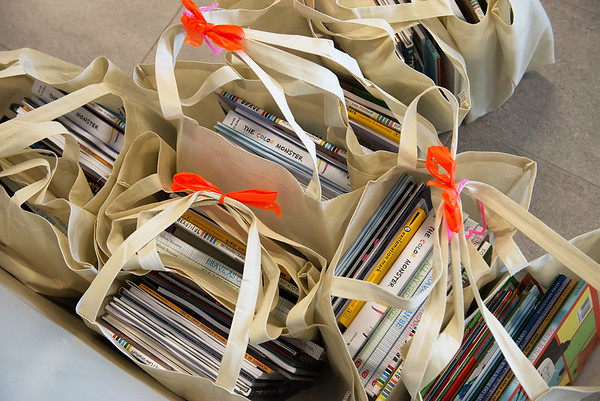 Books are donated by The Alliance of Southwest Missouri on Monday at Joplin High School.<br /> Globe | Roger Nomer