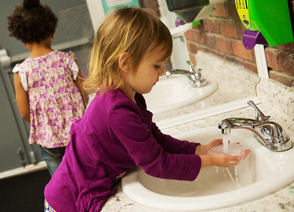 Phoebe Boyoston, 4, washes her hands before snack time at Midtown Head Start on Wednesday.<br /> Globe | Roger Nomer