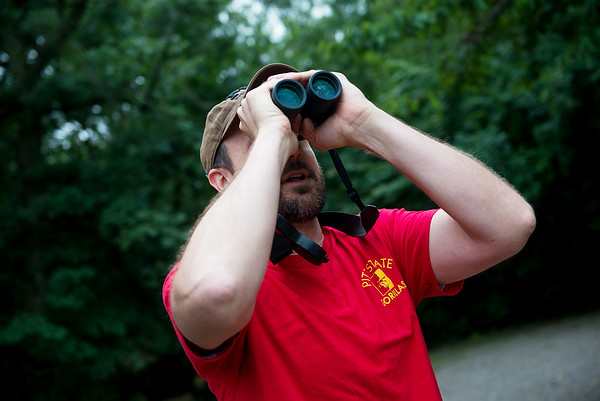Andrew George, assistant professor of biology at Pittsburg State University, looks for birds on Thursday at Wilderness Park in Frontenac.<br /> Globe | Roger Nomer