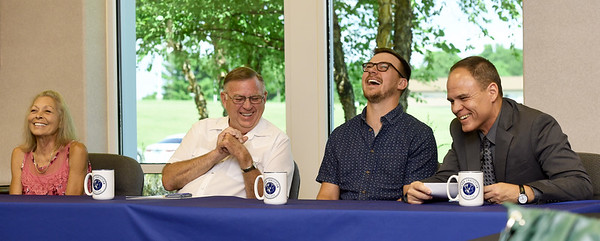 """""""Thanks a million,"""" jokes Ozark Christian College President Matt Proctor, right, after receiving a $1million check from the Bronson family of Grove, Oklahoma on Wednesday at OCC. The gift represented the single largest donation from living persons in the history of the college. From the left: Kat Bronson, Rick Bronson and their son Chad Bronson, a 2011 OCC graduate.<br /> Globe 