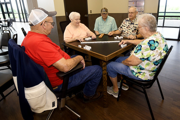 Local seniors gather for a spirited game of dominos on Thursday at the Joplin Senior Center.<br /> Globe | Laurie Sisk