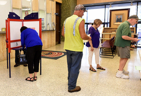 Voters cast their ballots on Tuesday during the August primaries at the Donald Clark Justice Center.<br /> Globe | Laurie Sisk