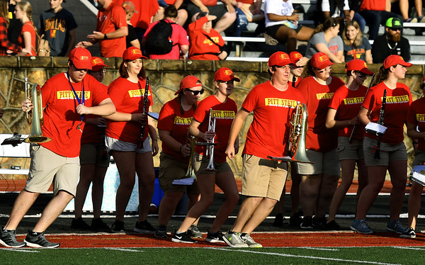 Members of the Pride of the Plains Marching Band get their groove on before their pregame performance at Pittsburg State's opening football game of the season on Thursday night at Carnie Smith Stadium.<br /> Globe | Laurie Sisk