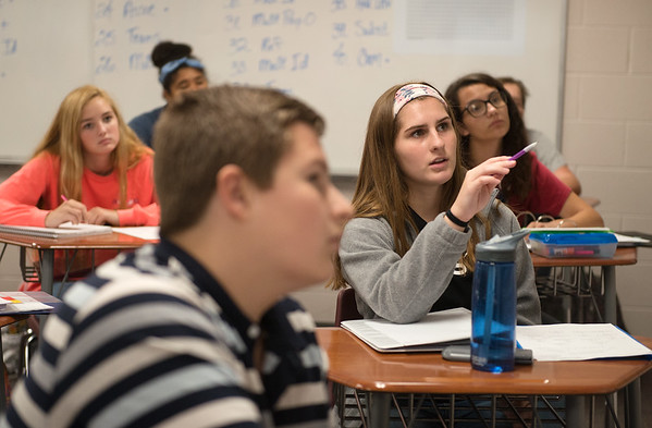 Emily Griesemer, sophomore, asks a question during Algebra class on Wednesday at College Heights Christian School.<br /> Globe | Roger Nomer