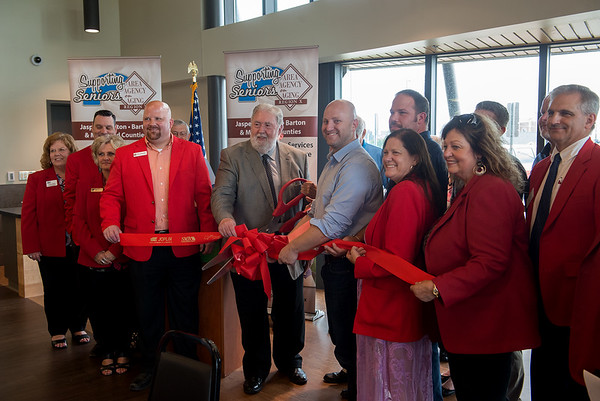The ribbon is cut on the new Joplin Senior Center at Mercy Park on Thursday. An open house and tour followed the ribbon cutting.<br /> Globe | Roger Nomer