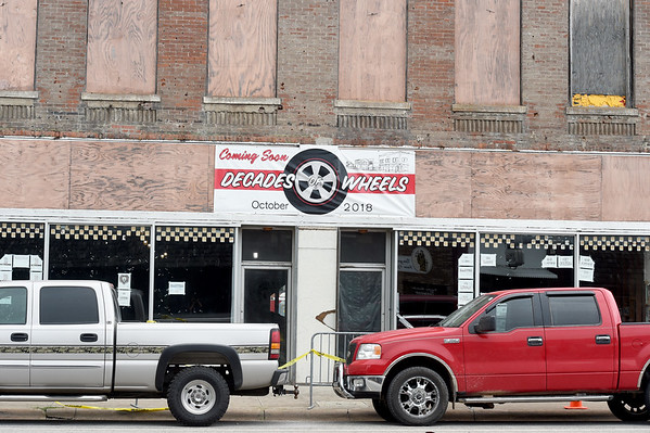 Work continues Friday on the Decades of Wheels Car Museum in downtown Baxter Springs. The development also will include a two restaurants, a bed and breakfast and an arcade. A grand opening is planned in mid-October.<br /> Globe | Laurie Sisk
