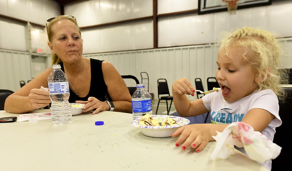 Four-year-old Molly Arnold enjoys a bowl of ice cream on a day out with her grandmother, Donna Brown on Friday afternoon during Community Support Services ice cream social at the Carl McConnell Activity Center. The event was part of CSS's year-long 40th Birthday celebration and an provided an opportunity for staff to get to know neighbors who live in the area around CSS.<br /> Globe | Laurie Sisk