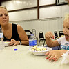 Four-year-old Molly Arnold enjoys a bowl of ice cream on a day out with her grandmother, Donna Brown on Friday afternoon during Community Support Services ice cream social at the Carl McConnell Activity Center. The event was part of CSS's year-long 40th Birthday celebration and an provided an opportunity for staff to get to know neighbors who live in the area around CSS.<br /> Globe   Laurie Sisk