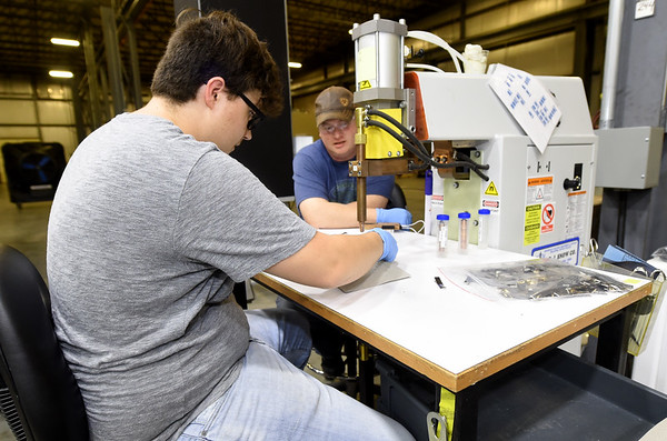 From the left: Charles Dodd receives training from Vic Koelling on a resistance welder on Thursday at ZAF Energy Sysytems. The company is one of several in the area who plan to expand their workforces.<br /> Globe | Laurie SIsk