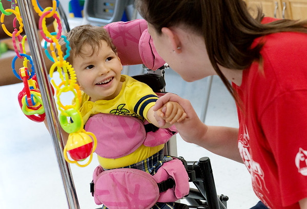 Ezra Reddick, 2, plays with Marissa Fields, teachers aide, at the Cerebral Palsy of Tri-County Center in Webb City on Tuesday.<br /> Globe | Roger Nomer