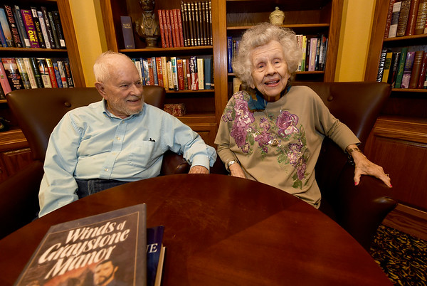 From the left: Frank Young looks adoringly at his wife Florlene Young as she recalls memories of her past on Tuesday at College View Manor. Frank is Florlene's primary caretaker as Florlene battles Alzheimer's.<br /> Globe | Laurie Sisk