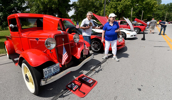 """From the left: Joe and Diane Reid Adams check out the classic cars and trucks with their puppy, """"Samuel Adams' on Saturday during the car show at Park Days in Ewert Park.<br /> Globe 